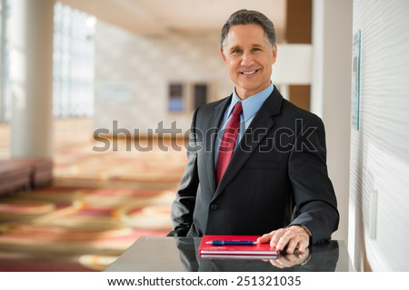Portrait of a handsome senior business man at the office  - stock photo