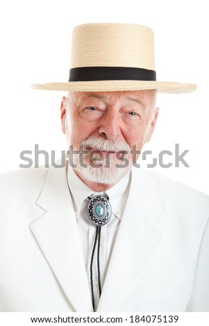 Portrait of a handsome senior man dressed in traditional Southern style.   - stock photo