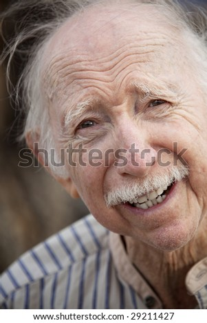 Portrait of a Handsome Senior Man Outdoors
