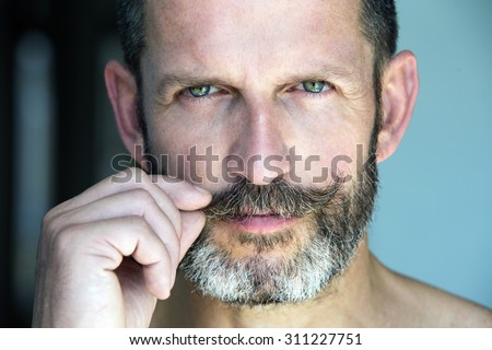 portrait of a handsome smiling man with beard - stock photo