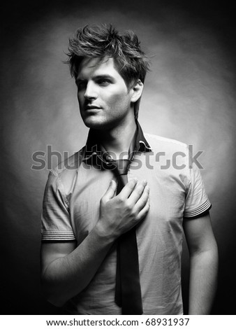 Portrait of a handsome stylish man with a cool hairstyle - stock photo