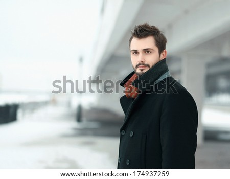 Portrait of a handsome stylish young man brunette outdoors looks away  - stock photo