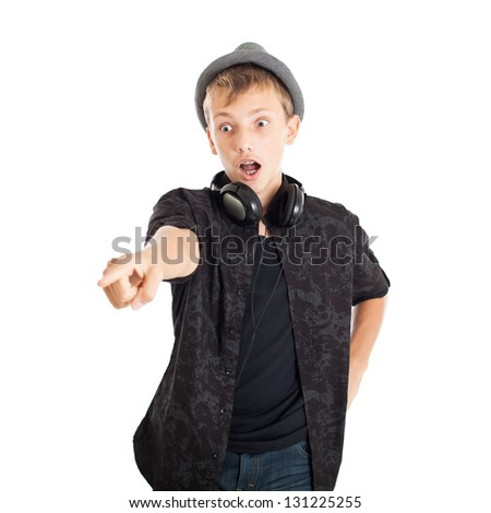 Portrait of a Handsome teen boy wearing a European black shirt and hat. The boy is very surprised and showing his hand forward. Studio shot, isolated on white background. - stock photo
