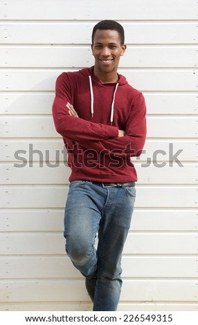 Portrait of a handsome young african man smiling on white background - stock photo