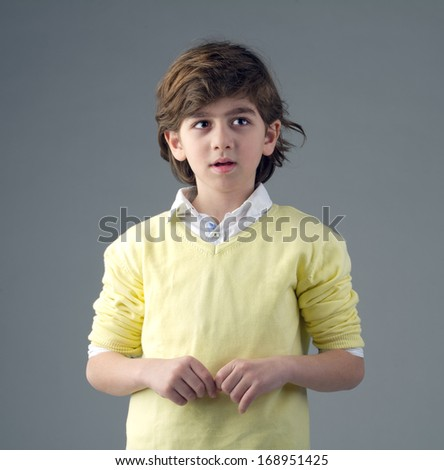 Portrait of a handsome young boy isolated - stock photo