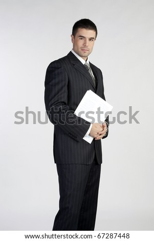 Portrait of a handsome young business man - stock photo