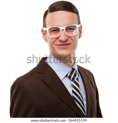 Portrait of a handsome young business man in gesture of reaching the goal against white background - stock photo