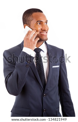 Portrait of a handsome young business man speaking on the mobile isolated on white background - stock photo