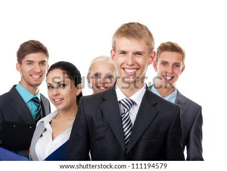 Portrait of a handsome young business man with colleagues in background, Business people group, young businesspeople standing together happy smile, Isolated over white background - stock photo