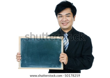 Portrait of a handsome young businessman holding a blackboard against white background.