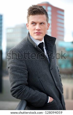 Portrait of a handsome young businessman standing outdoors