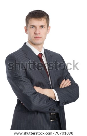 Portrait of a handsome young businessman with a serious glance. - stock photo