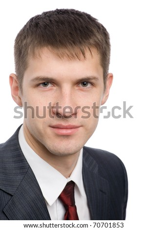 Portrait of a handsome young businessman with a slight smile on his face. - stock photo