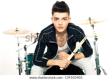 Portrait of a handsome young drummer with his drum set - stock photo