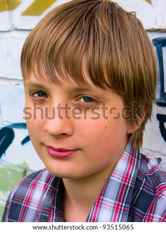 Portrait of a handsome young guy in a  shirt - stock photo