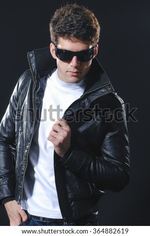 Portrait of a handsome young male-black background - stock photo