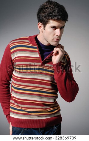 Portrait of a handsome young male in sweater dress - stock photo