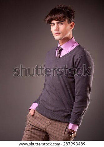 portrait of a handsome young male model with serious attitude- studio shoot - stock photo