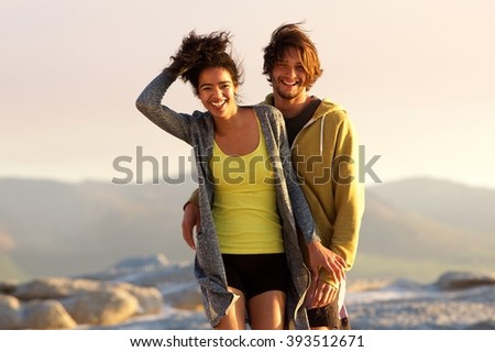Portrait of a handsome young man and smiling woman outdoors - stock photo
