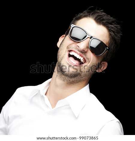 portrait of a handsome young man enjoying over black background - stock photo