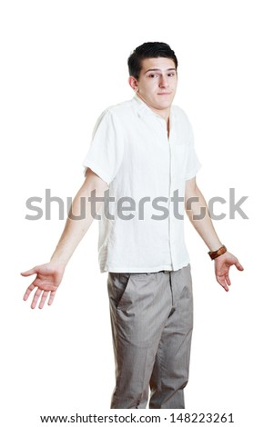 Portrait of a handsome young man gesturing do not know sign against white background  - stock photo