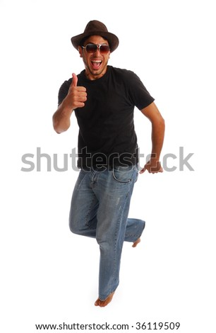 Portrait of a handsome young man giving the thumbs up - stock photo