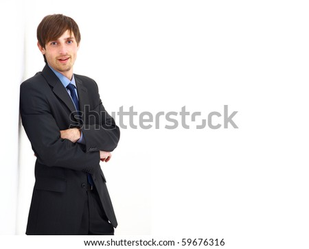 Portrait of a handsome young man in a business suit. - stock photo