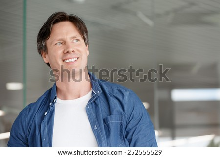 Portrait of a handsome young man in an office