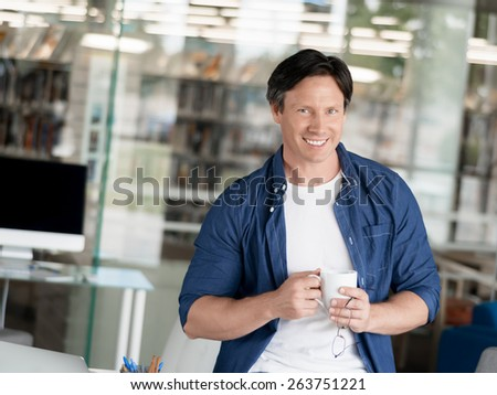 Portrait of a handsome young man in an office - stock photo