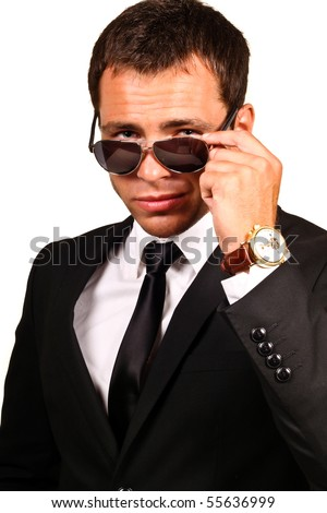 Portrait of a handsome young man in elegant suit and sunglasses. - stock photo