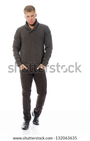 Portrait of a handsome young man in fashionable clothing. Isolated on a white background