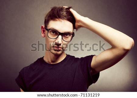 Portrait of a handsome young man in glasses