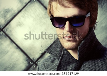 Portrait of a handsome young man in sunglasases. Beauty, fashion. Studio shot. - stock photo