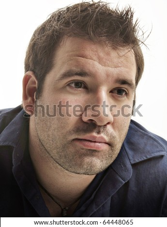 Portrait of a handsome young man isolated against white background