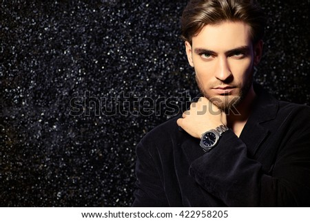Portrait of a handsome young man. Men's beauty, fashion. Hairstyle.  - stock photo