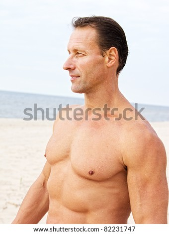 Portrait of a handsome young man on the beach