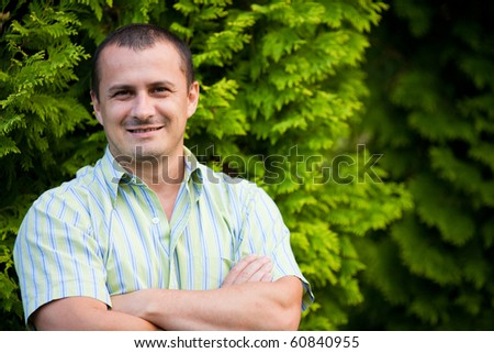 Portrait of a handsome young man outdoor - stock photo