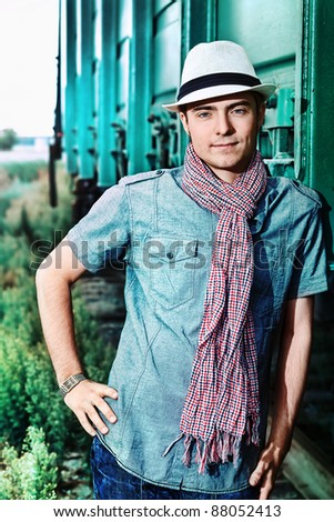 Portrait of a handsome young man posing outdoor. - stock photo