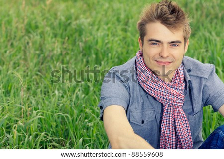 Portrait of a handsome young man posing outdoor.
