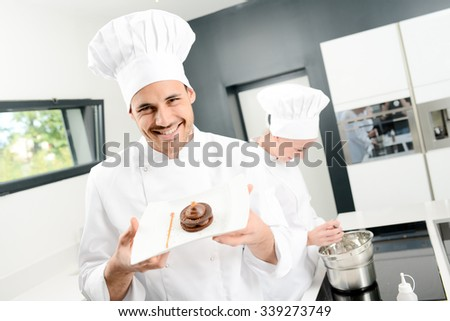 portrait of a handsome young man professional pastry cook preparing a chocolate dessert