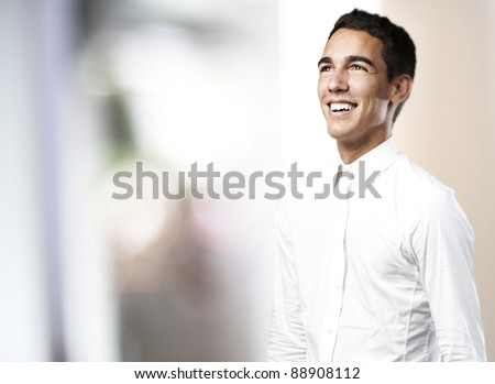portrait of a handsome young man smiling against a abstract background - stock photo