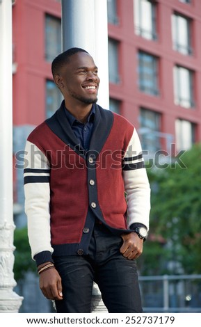 Portrait of a handsome young man smiling outdoors