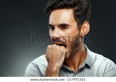 portrait of a handsome young man thinking studio shot - stock photo