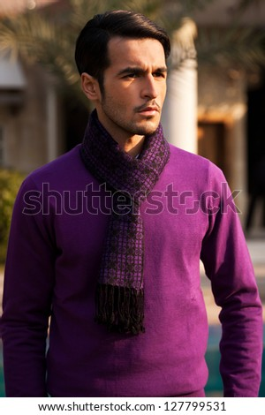 portrait of a handsome young man wearing sweater in outdoor - stock photo