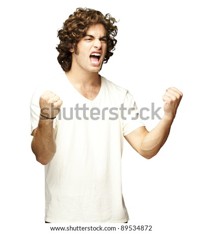 portrait of a handsome young man winning over white background