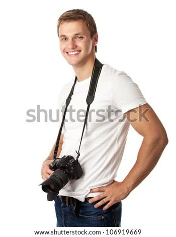 Portrait of a handsome young man with a camera against white background - stock photo