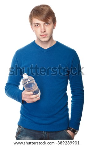 portrait of a handsome young man with a water bottle over a white background - stock photo