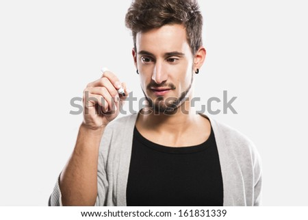 Portrait of a handsome young man writting something on a glass writeboard - stock photo