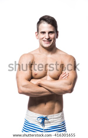 Portrait of a handsome young muscular man in swimwear with hands folded isolated on white background - stock photo
