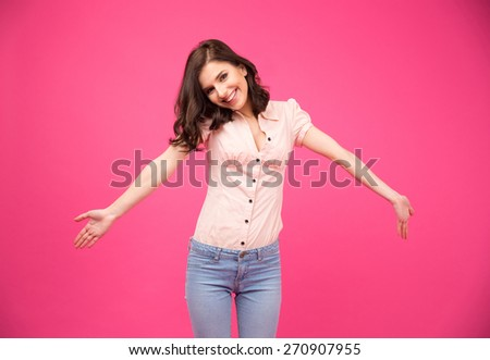 Portrait of a happiness young woman glad to see you over pink background - stock photo